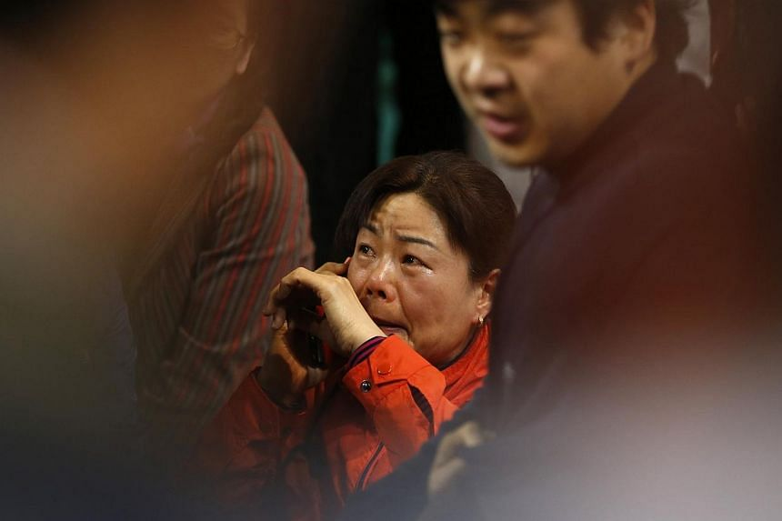 A family member of a missing passenger on the South Korean ferry Sewol, which sank at sea, cries as she wait for news from a rescue team at a gym in Jindo on April 17, 2014. -- PHOTO: REUTERS