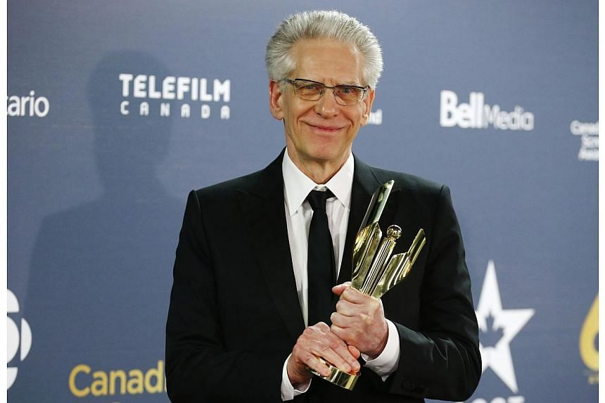 Director David Cronenberg holds his Lifetime Achievement Award at the 2014 Canadian Screen awards in Toronto on March 9, 2014.  Movies by David Cronenberg, Jean-Luc Godard, Mike Leigh and Ken Loach are among the films selected to compete fo