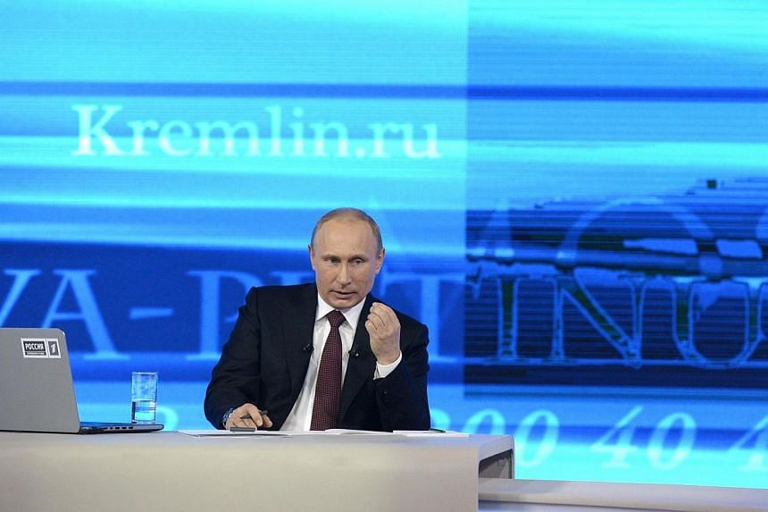 """Russia's President Vladimir Putin gives his annual televised question-and-answer session with the nation in Moscow, on April 17, 2014.Mr Putin accused Ukraine's leaders on Thursday, April 17, 2014,of committing a""""grave crime"""" by using the"""