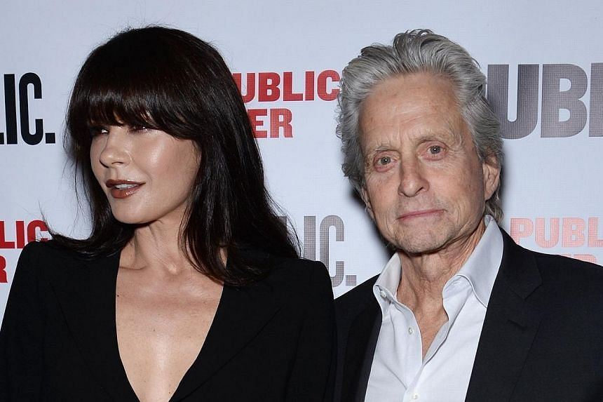 Actors Catherine Zeta-Jones (left) and Michael Douglas attend The Library opening night celebration at The Public Theater on April 15, 2014 in New York City. Douglas, 69, and Zeta-Jones, 44, on Tuesday, April 15, 2014, made their first red carpet app