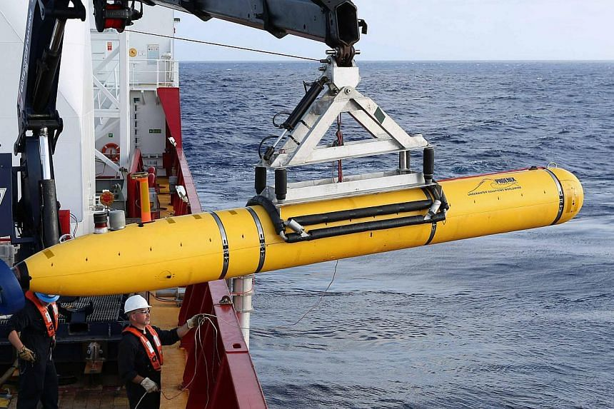 The US Navy's Bluefin-21 autonomous underwater vehicle being positioned for deployment in the southern Indian Ocean to look for the missing Malaysia Airlines flight MH370 on April 14, 2014. -- PHOTO: REUTERS