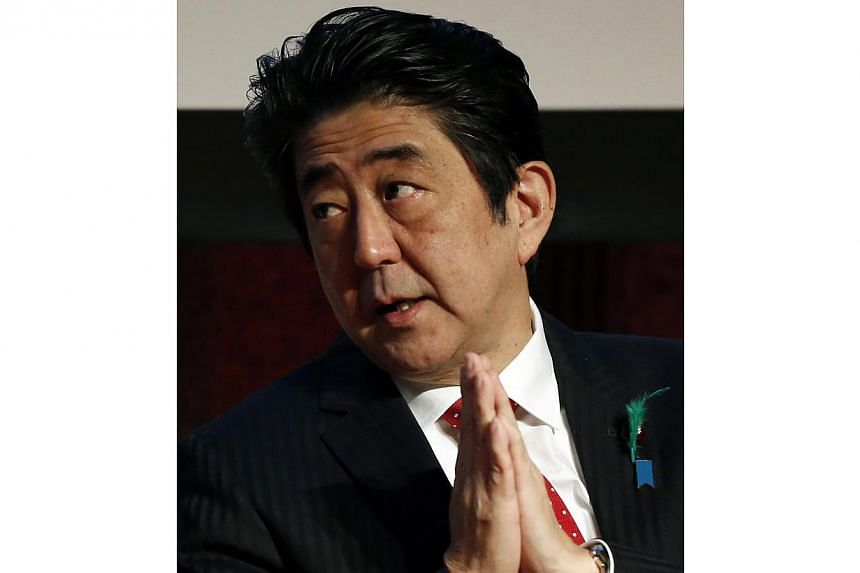 "Japan's Prime Minister Shinzo Abe offered ""heartfelt sympathy"" on Thursday to those affected by the ferry disaster in South Korea, in a rare moment of detente between the feuding neighbours. -- PHOTO: REUTERS"