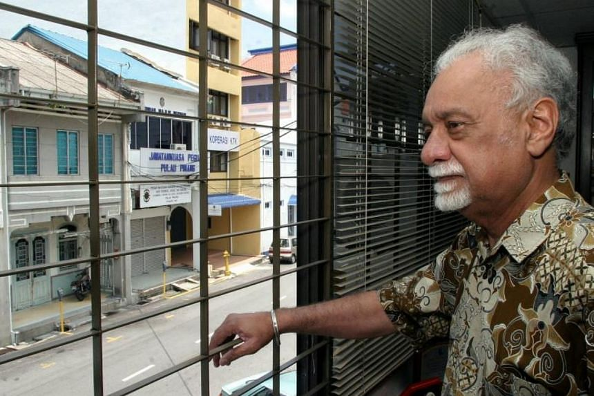Karpal Singh looks out of his office window in Green Hall along the road where his father Ram Singh once used to live upon arriving in Penang from India.-- FILE PHOTO: THE STAR/ ASIA NEWS NETWORK