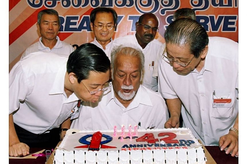 DAP secretary-general Lim Guan Eng (left), national chairman Karpal Singh (centre), adviser Lim Kit Siang (right) blowing the candles on the party's 42nd anniversary cake.-- FILE PHOTO: THE STAR/ ASIA NEWS NETWORK