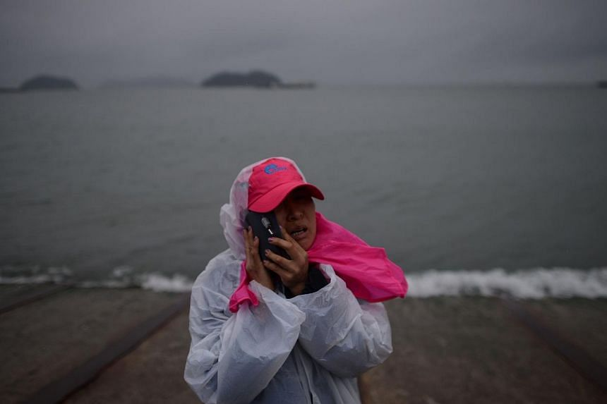 A relative waits on a pier in Jindo on April 17, 2014, as the frantic search for nearly 300 people, most of them schoolchildren, missing after a South Korean ferry capsized extended into a second day, as distraught relatives maintained an agonising v