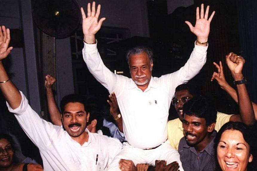 Karpal Singh was lifted up into the air by his family and supporters after the announcement that he had won the Jelutong parliamentary seat.-- FILE PHOTO: THE STAR/ ASIA NEWS NETWORK