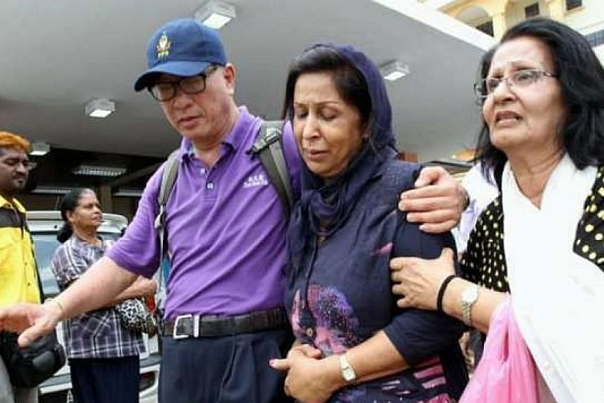 Karpal Singh's wife, Gurmit Kaur (middle), being whisked out of the Ipoh Hospital mortuary by Penang state executive councillor Phee Boon Poh (left).-- PHOTO: THE STAR/ ASIA NEWS NETWORK
