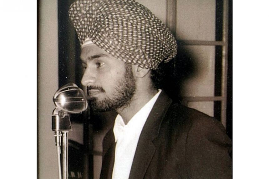 A young Karpal SIngh, who was the president of the Dunearn Hostel at the University of Singapore in 1963, delivering a speech.-- FILE PHOTO: THE STAR/ ASIA NEWS NETWORK