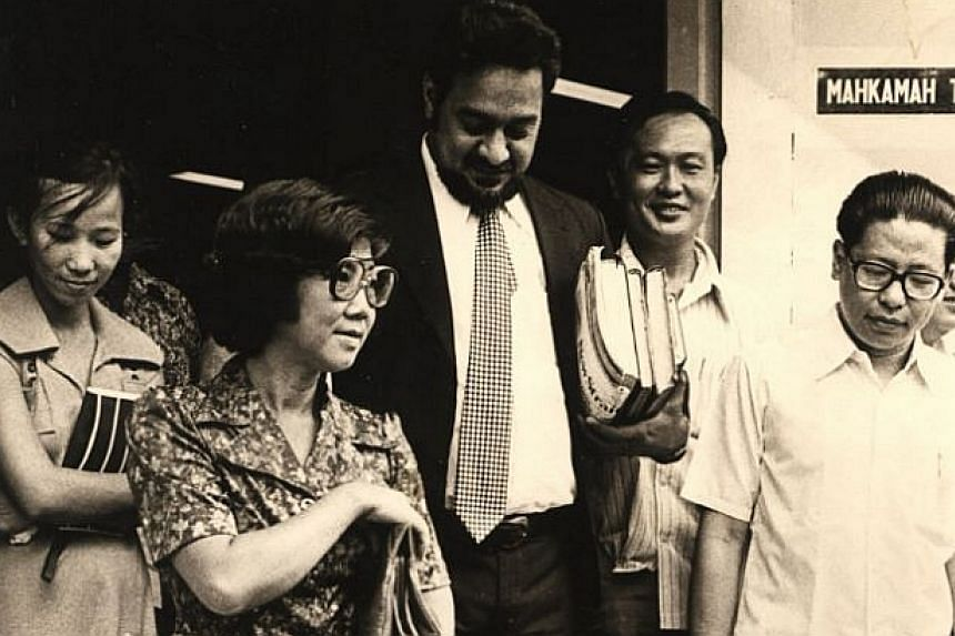 1978: Lim Kit Siang (right, in glasses) leaving the court with Karpal Singh (centre).-- FILE PHOTO: THE STAR/ ASIA NEWS NETWORK