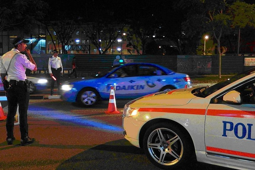 Twenty-two motorists who got behind the wheel despite having had too much to drink were nabbed by the traffic police in an island-wide operation on Thursday, April 17, 2014. -- PHOTO: SINGAPORE POLICE FORCE