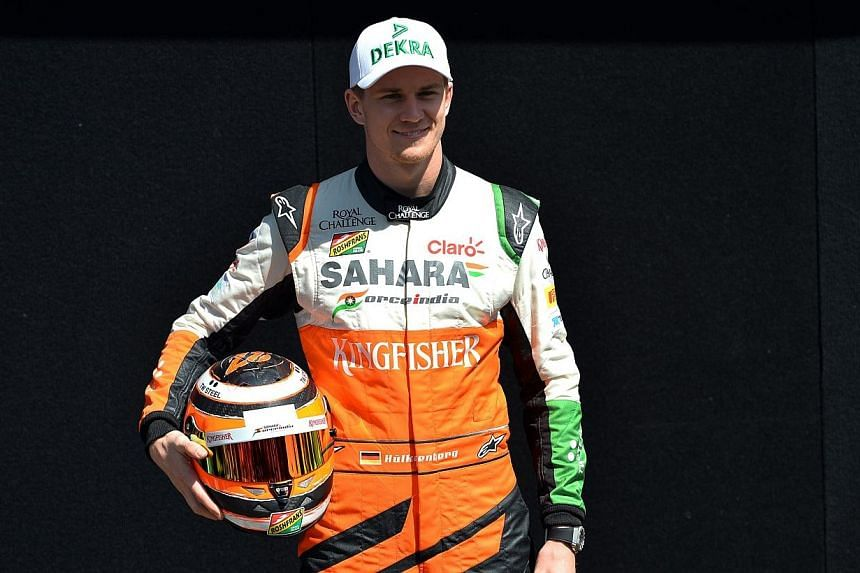 Force India driver Nico Hulkenberg of Germany poses during a photo shoot ahead of the Formula One Australian Grand Prix in Melbourne on March 13, 2014.Nico Huelkenberg on Thursday, April 17, 2014, denied reports that Formula One drivers were th