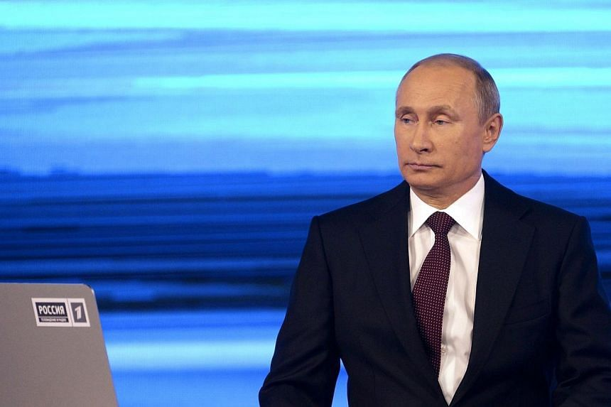Russia's President Vladimir Putin gives his annual televised question-and-answer session with the nation in Moscow on Thursday, April 17, 2014. Mr Putin on Thursday accused Ukraine's new authorities of driving the country towards the abyss but s