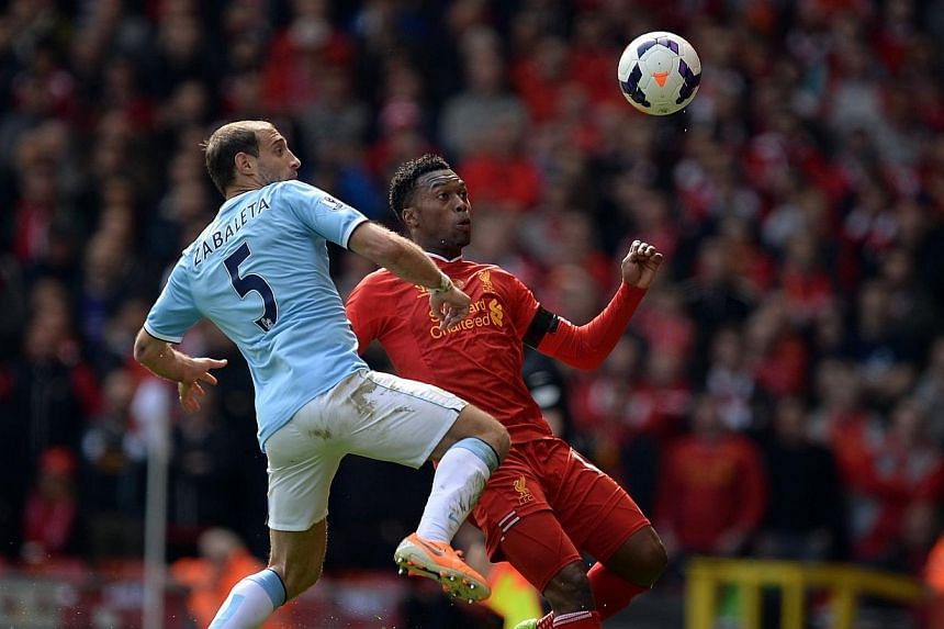 Liverpool's Daniel Sturridge is challenged by Manchester City's Pablo Zabaleta at Anfield on April 13, 2014.Sturridge is an injury concern ahead of the English Premier League leaders' trip to Norwich City on Sunday, April 19, 2014, because of a