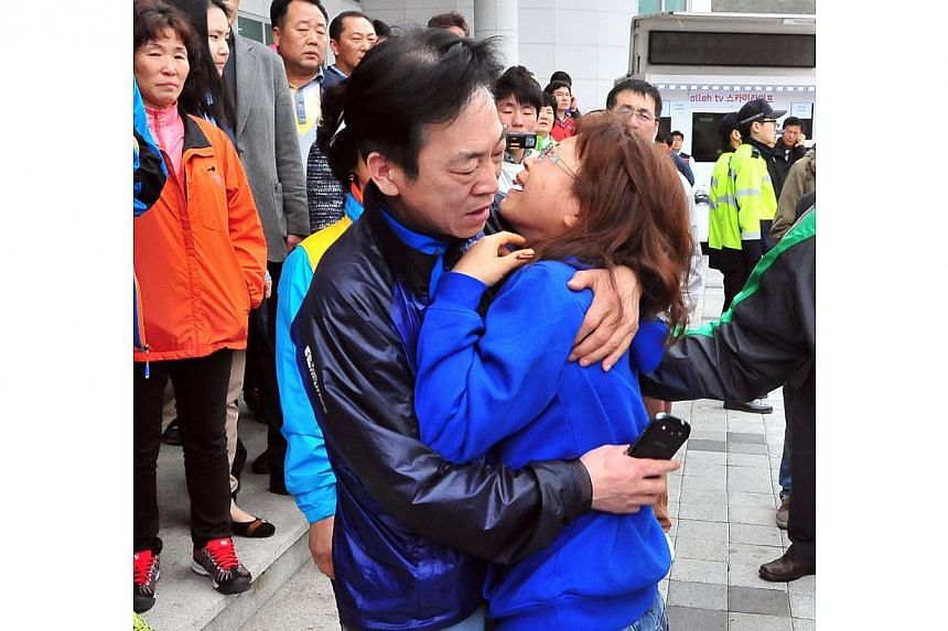 A South Korean relative (right) of a passenger on board the capsized ferry is distraught as she waits for news at a gym in Jindo on April 17, 2014. -- PHOTO: AFP