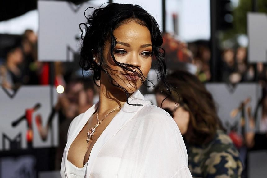 Singer Rihanna arrives at the 2014 MTV Movie Awards in Los Angeles, California on April 13, 2014. Pop star Rihanna has agreed to settle a lawsuit with her former accountants accusing them of mismanaging her finances and costing her millions of dollar
