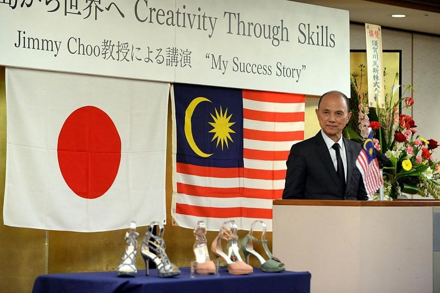 Malaysian designer Jimmy Choo is introduced during his lecture Creativity Thugh Skills in Fukushima city on April 18, 2014.Choo unveiled a one-off range of shoesmade using materials and techniques native to the disaster-hit Fukushima area