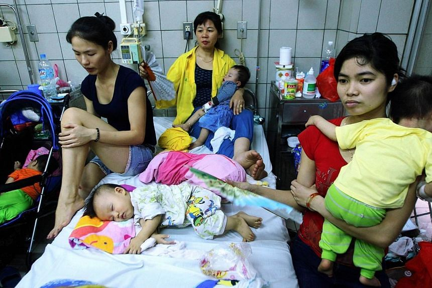 Families with their children suffering from measles at a state-run hospital in Hanoi taken on April 17, 2014.Vietnam is scrambling to contain a deadly outbreak of measles that has killed more than 100 people, mostly young children, and infected
