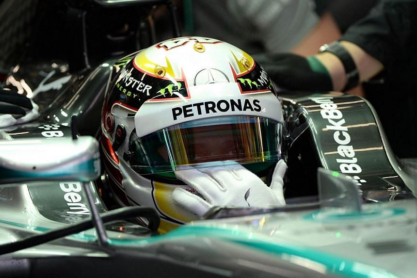 Mercedes driver Lewis Hamilton of Britain waits to take his car out during the first practice session of the Formula One Chinese Grand Prix in Shanghai on April 18, 2014.Hamilton battled back on Friday, April 18, 2014, to set the fastest time i