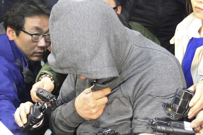 Lee Joon Seok (centre), captain of the South Korean ferry Sewol which sank at sea off Jindo, is investigated at Mokpo police station in Mokpo April 17, 2014. South Korean prosecutors said on Friday that The captain was not in command when the acciden