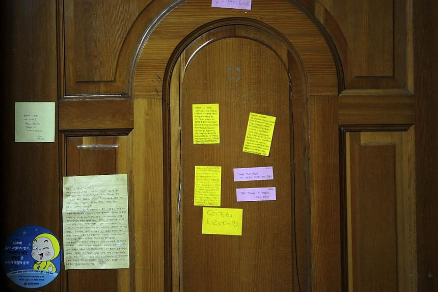Letters are pictured on the door of a locked classroom at Danwon High School where missing students are enrolled in Ansan on April 17, 2014. -- PHOTO: AFP