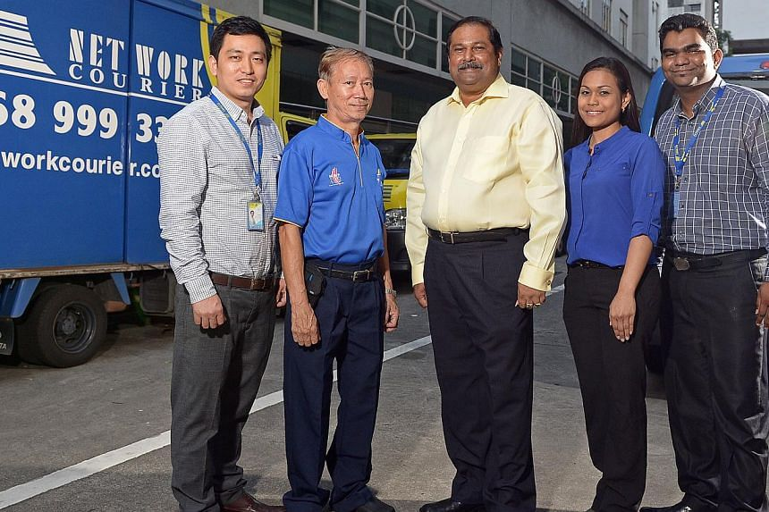 GSK Global boss Eric Tan (left), 47, discourages his staff from staying late in the office. Network Courier managing director V.S. Kumar (above, centre), with employees (from left) Simon Sun, Chin Gim Soon, Aslinna Dollah and Rajah Raman. Mr Kumar pl