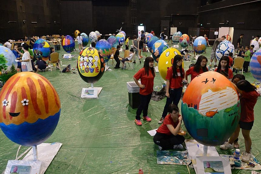 The eggs were painted in different designs by about 200 people aged nine to 55, including local artists and students. -- ST PHOTO: NG SOR LUAN