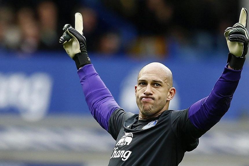 Everton's goalkeeper Tim Howard reacts after their English Premier League soccer match against Arsenal at Goodison Park in Liverpool, northern England, April 6, 2014. Tim Howard signed a contract extension on Thursday which will keep him at the