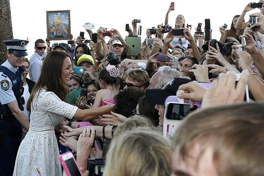 Catherine, the Duchess of Cambridge, greets a crowd gathered near a surf lifesaving demonstration at Sydney's Manly beach on April 18, 2014. -- PHOTO: REUTERS