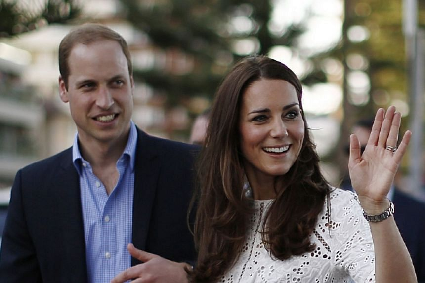 Britain's Prince William and his wife Catherine, the Duchess of Cambridge, smile during their visit to a surf lifesaving demonstration at Sydney's Manly beach on April 18, 2014. -- PHOTO: REUTERS