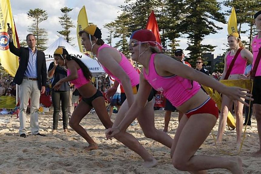 Britain's Prince William starts a beach sprint race for junior lifesavers during his visit to a surf lifesaving demonstration at Sydney's Manly beach on April 18, 2014. -- PHOTO: REUTERS