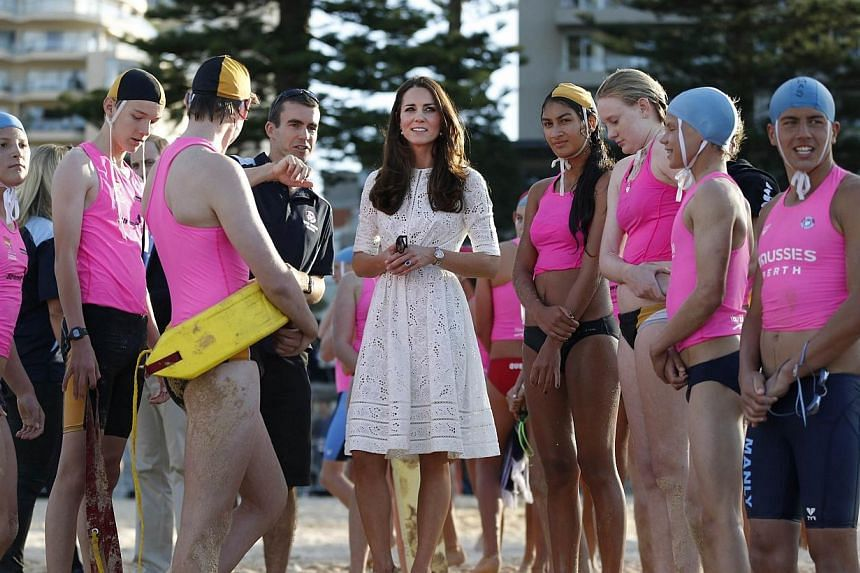 Catherine, the Duchess of Cambridge, meets with junior surf lifesavers during her visit to a surf lifesaving demonstration at Sydney's Manly beach on April 18, 2014. -- PHOTO: REUTERS