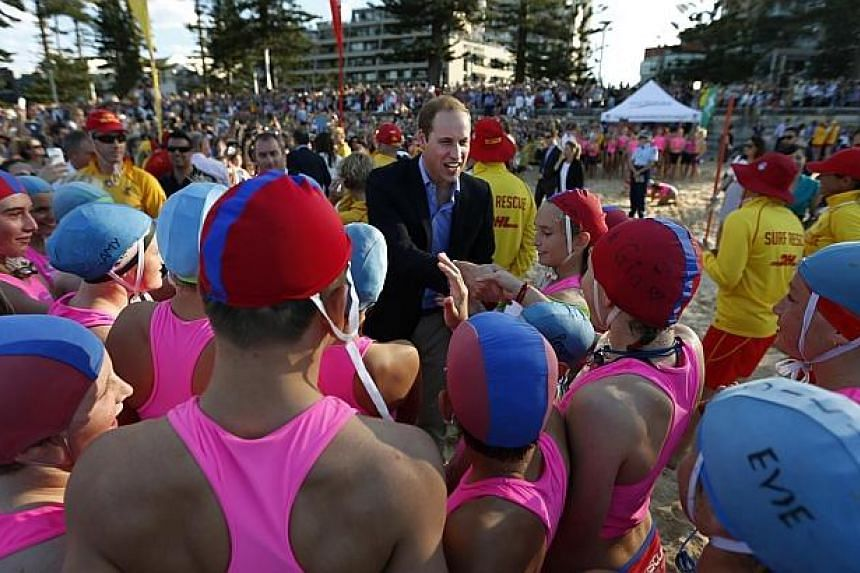 Britain's Prince William meets with junior surf lifesavers during his visit to a surf lifesaving demonstration at Sydney's Manly beach on April 18, 2014. -- PHOTO: REUTERS