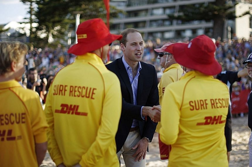 Britain's Prince William meets participants at a surf lifesaving demonstration at Sydney's Manly beach on April 18, 2014. -- PHOTO: REUTERS