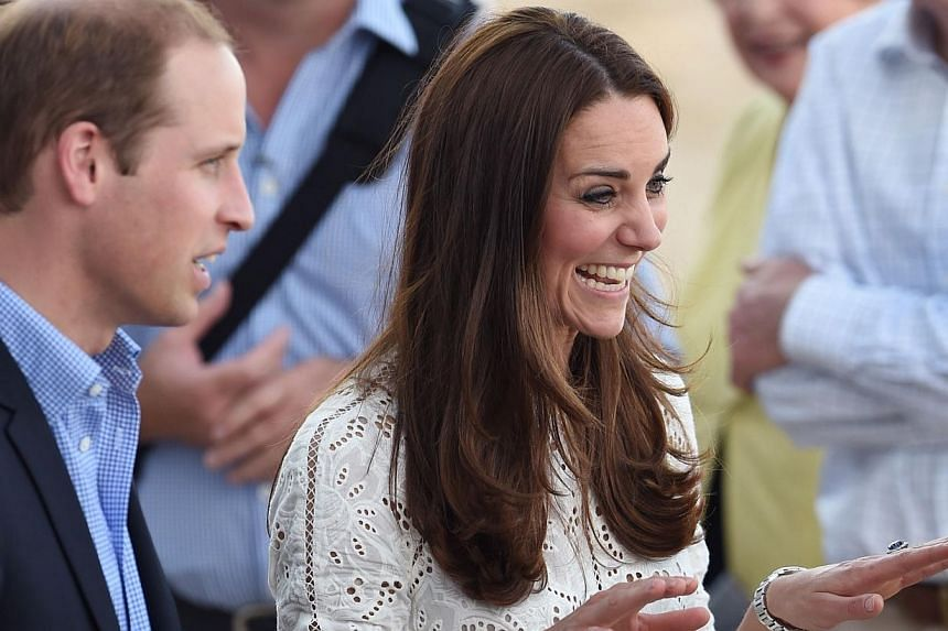 Catherine, the Duchess of Cambridge, and Prince William speak to people on the beach at Manly, on Sydney's north shore on April 18, 2014. -- PHOTO: AFP