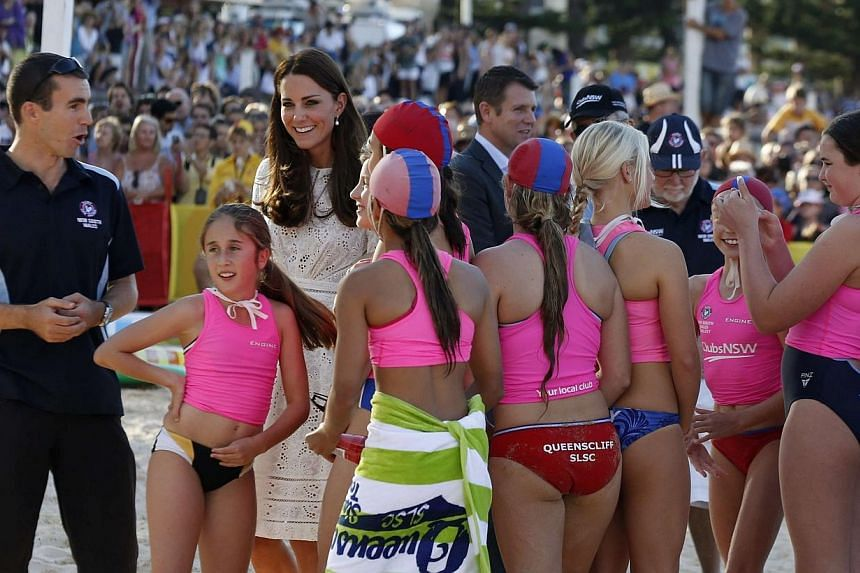 Catherine, Britain's Duchess of Cambridge, smiles as she walks among junior surf lifesavers during her visit to a surf lifesaving demonstration at Sydney's Manly beach on April 18, 2014. -- PHOTO: REUTERSCatherine, Britain's Duchess of Cambridge, tal