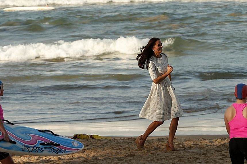 Catherine, Britain's Duchess of Cambridge, runs across Manly beach in Sydney on April 18, 2014.-- PHOTO: REUTERS