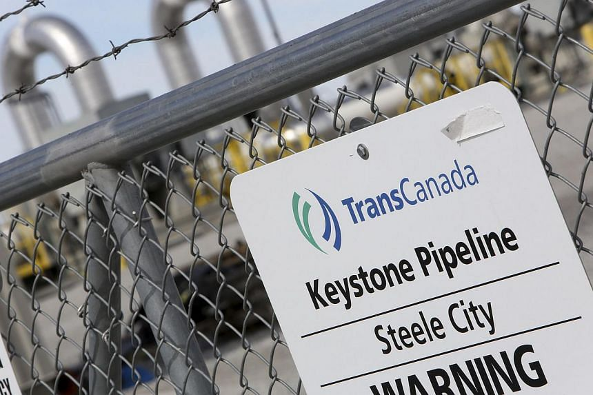 A TransCanada Keystone Pipeline pump station operates outside Steele City, Nebraska on March 10, 2014. The US State Department announced on Friday it is extending the government comment period on the Keystone XL pipeline. -- FILE PHOTO: REUTERS