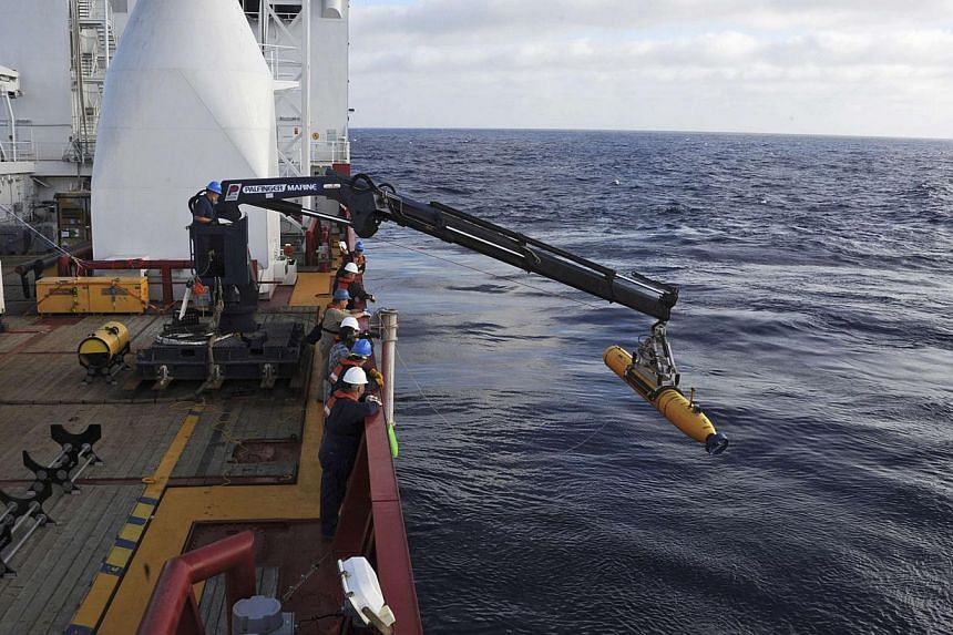 Operators aboard the Australian Defense Vessel Ocean Shield move the US Navy's Bluefin 21 autonomous underwater vehicle into position for deployment in the Southern Indian Ocean, as the search continues for the missing Malaysia Airlines Flight 370, o