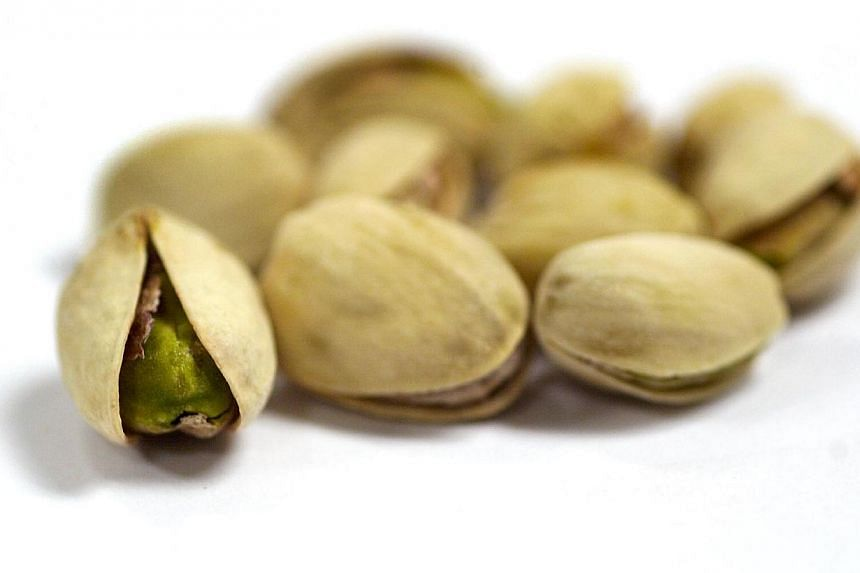 """Pistachios are already a key ingredient in Turkish baklava, but the country may now have found a new way to exploit the nuts known as """"green gold"""" - by using their shells to heat a new eco-city. -- ST FILE PHOTO:TERENCE TAN"""