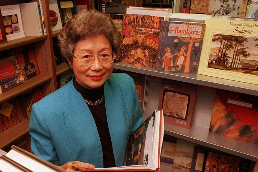Mrs Lim (left), then 59, at her bookshop, a month before Select celebrated its 20th anniversary in 1996.-- PHOTO: BT FILE