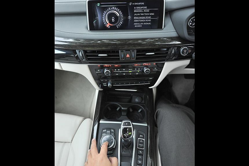 The navigation system of the BMW X5 50i recognises handwriting – so drivers can spell out their destinations – and also takes voice instructions. -- PHOTO: LIM YAOHUI FOR THE STRAITS TIMES