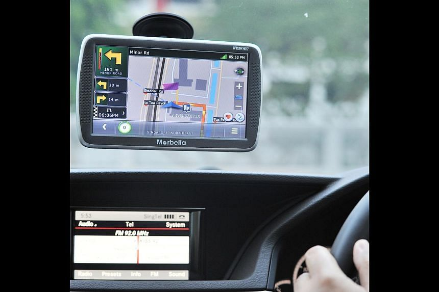 The Garmin Head-Up Display is user-friendly, projecting navigation instructions on the windscreen, while the Marbella uNav (above) gives clear audio and visual instructions. -- PHOTO: LIM YAOHUI FOR THE STRAITS TIMES