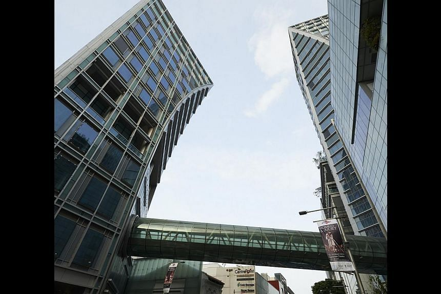 An exterior shot of Orchard Gateway showing the glass link bridge that connects the two buildings that are diagonally opposite each other. -- PHOTO: ORCHARD GATEWAY