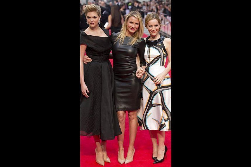 Actress Cameron Diaz (above centre) with cast members Kate Upton (left) and Leslie Mann (right) at the gala screening of The Other Woman in London and the trio in a scene from the movie. -- PHOTO: REUTERS