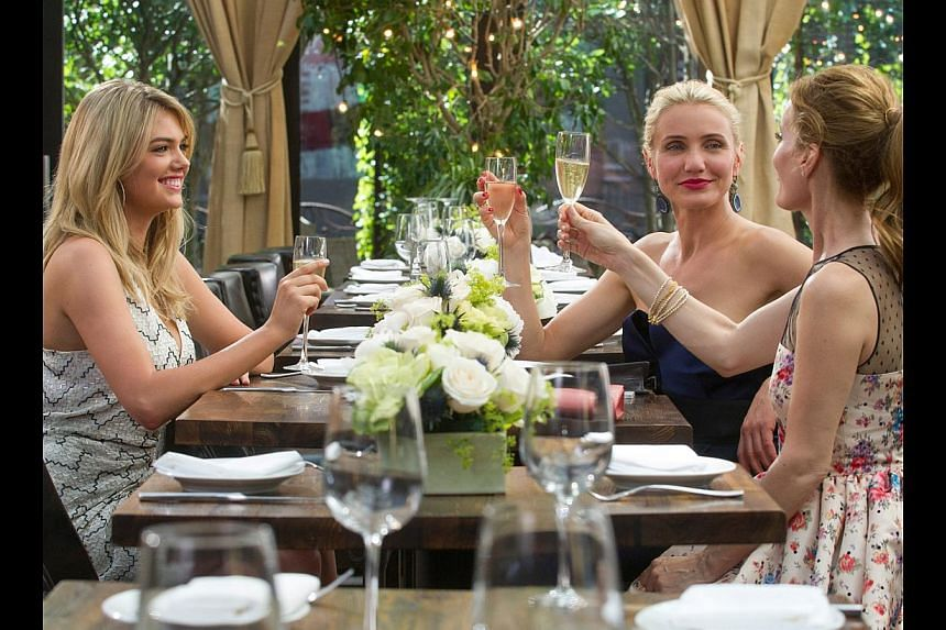 Actress Cameron Diaz with cast members Kate Upton and Leslie Mann at the gala screening of The Other Woman in London and the trio in a scene (above) from the movie. -- PHOTO: TWENTIETH CENTURY FOX