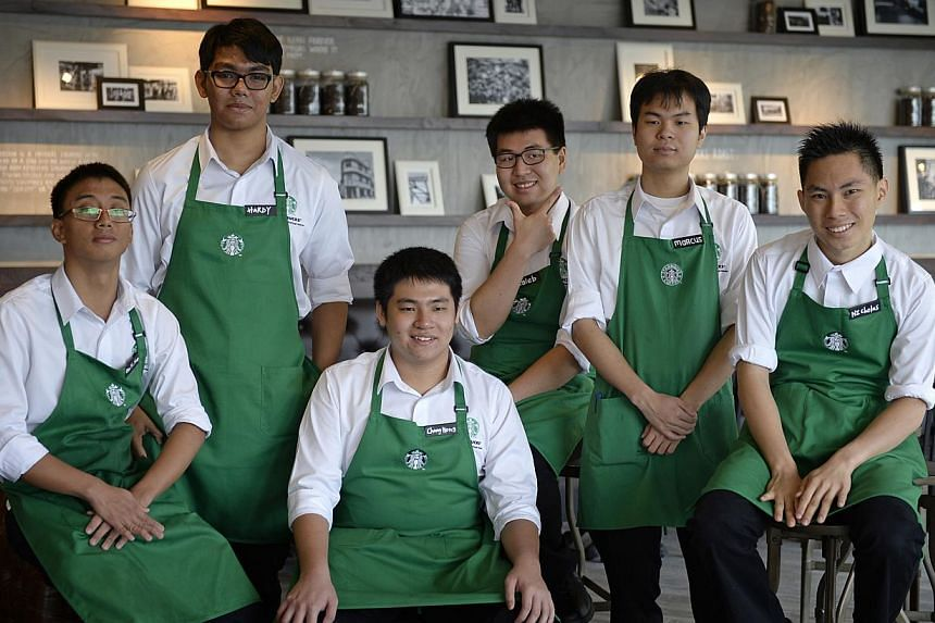 Autism Resource Centre clients (from left) Chia Yu Xuan, Hardy Jaafar, Fan Chang Hong, Caleb Lim, Marcus Lim and Nicholas Neo work at Starbucks. The global coffee chain is among a growing list of companies, including fashion retailer Uniqlo, that are