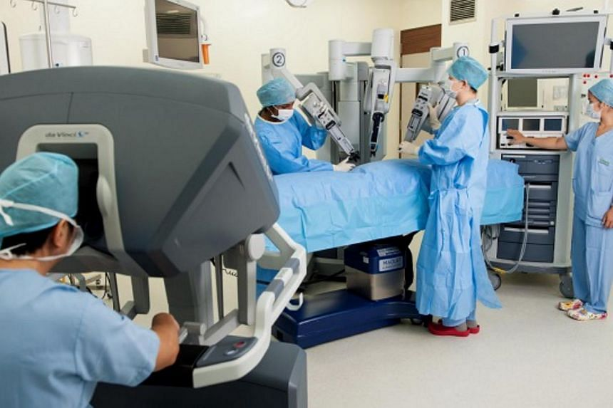 Surgeons using a robot to conduct a minimally invasive surgery for colorectal cancer.The rate at which people develop the cancer appears to have plateaued, suggestingthat preventive measures here, including screening, may be working.&nbsp