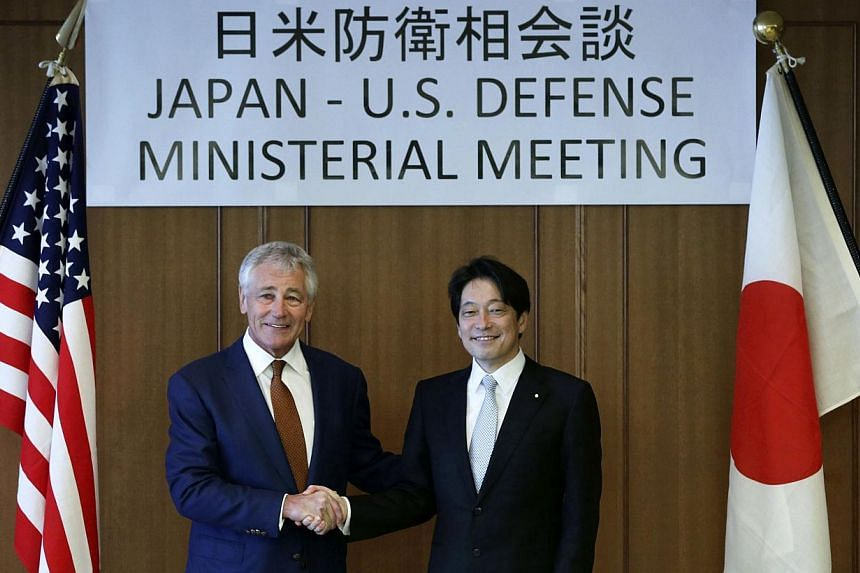 US Secretary of Defense Chuck Hagel shaking hands with Japan's Defence Minister Itsunori Onodera before a bilateral meeting at the Japanese Ministry of Defence headquarters in Tokyo on April 6, 2014. -- FILE PHOTO: REUTERS