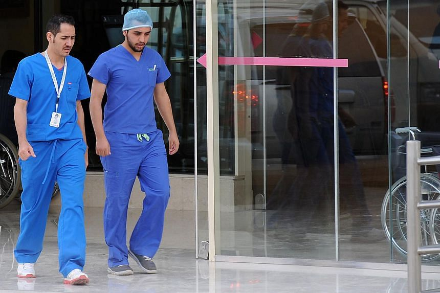 Saudi medical staff leaving the emergency department at a hospital in the center of the Saudi capital Riyadh on April 8, 2014. The Health Ministry reported four more MERS cases in Jeddah, two of them among health workers, prompting authorities to clo