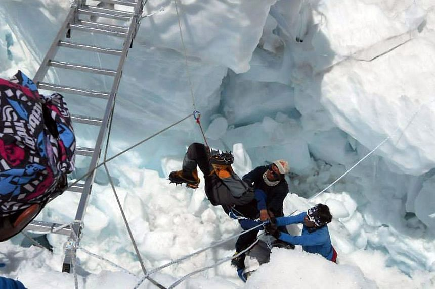 Nepalese rescue team members rescue a survivor of an avalanche on Mount Everest, on April 18, 2014. Rescuers searched Mount Everest for bodies on Saturday, April 19, 2014, as authorities ruled out hope of finding any more survivors from an